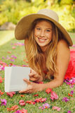 Young Woman Reading Book Outside Royalty Free Stock Image