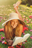 Young Woman Reading Book Outside Royalty Free Stock Photos