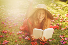 Young Woman Reading Book Outside Stock Photos