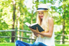 Young woman reading a book outside Stock Image