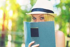 Young woman reading a book outside Royalty Free Stock Photo