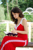 Young woman reading a book in the park. Royalty Free Stock Photography