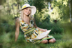 Young woman reading a book Stock Image