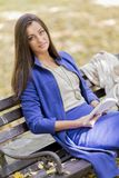 Young woman reading book in the park. Young woman reading a book in the park Royalty Free Stock Image