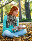 Young woman reading Stock Images