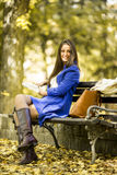 Young woman reading a book in the park. Woman reading a book in the park Royalty Free Stock Photos