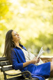 Young woman reading a book in the park. Woman reading a book in the park Royalty Free Stock Image