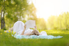 Young woman reading a book in the Park. Stock Image