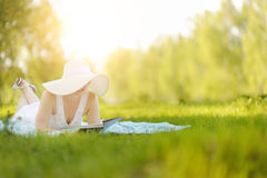 Young woman reading a book in the Park. Royalty Free Stock Photo