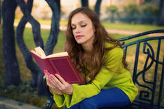 Young Woman Reading book in the Park Royalty Free Stock Image