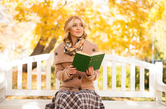 Young woman reading a book in a park Stock Photography