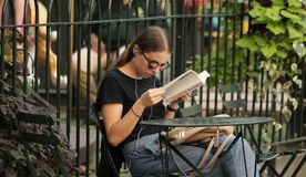 A young woman Reading a book in the Park stock image