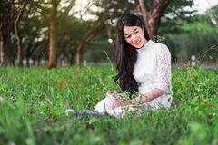 Woman reading a book in the park. Young woman reading a book in the park Stock Images
