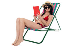 Young woman reading book and relaxing Stock Image