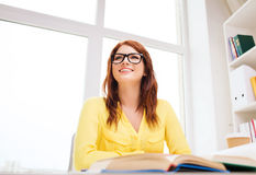 Young woman reading book at school Stock Photography