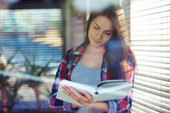Young woman reading Stock Photo