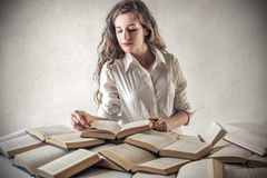 Young woman reading a book Royalty Free Stock Image