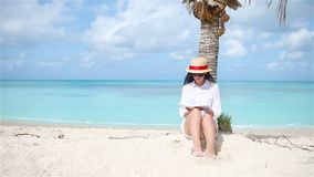 Young woman reading book during tropical white beach. Young woman reading on tropical white beach stock video footage