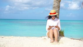 Young woman reading book during tropical white beach. Young woman reading on tropical white beach stock footage