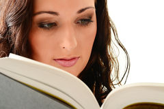 Young woman reading a book on white. Background royalty free stock photography