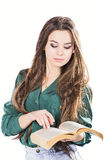 Young woman reading a book on white background.  Royalty Free Stock Photos
