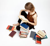 Young woman reading books Stock Images