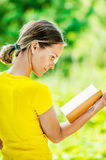 Young woman reading books Royalty Free Stock Photography