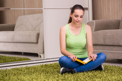 The young woman reading books at home Royalty Free Stock Images