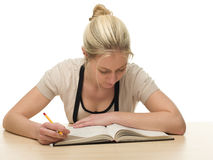 Young Woman Reading Books for School Royalty Free Stock Photo