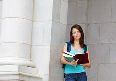 Young woman reading on campus Stock Images