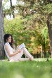 Young woman reading Stock Photos