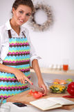 Young woman reading cookbook in the kitchen, Stock Photo