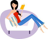Young woman reading on the couch Royalty Free Stock Photo