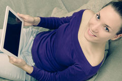 Young woman using digital tablet at home stock image