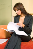 Young woman reading document stock image