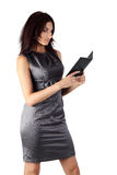 Young woman reading electronic book. Young woman isolated on the whte reading electronic book Royalty Free Stock Images