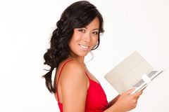 Young Woman Reading The Electronic Book Royalty Free Stock Photography