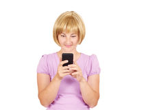 Young woman reading good news on the phone. Stock Photography