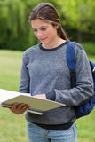 Young woman reading her notebook Stock Images
