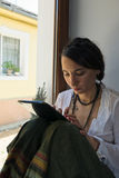 Young woman reading from her tablet Stock Photos