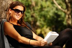 Free Young Woman Reading In The Park Royalty Free Stock Photo - 16281185