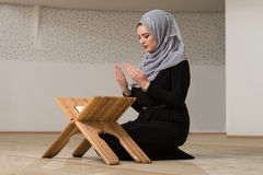 Young Woman Reading The Koran At The Mosque Stock Photo