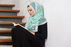 Young Woman Reading The Koran At The Mosque Stock Photography