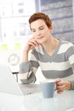 Young woman reading on laptop Stock Image