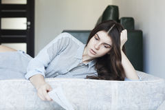 Young woman reading. Young woman laying and reading Royalty Free Stock Photos
