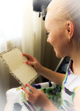 Young Woman reading letter. Young smiling woman reading love letter on Valentine's Day royalty free stock photography