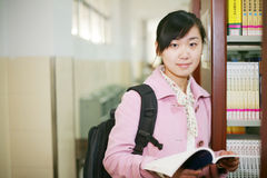 Young woman reading in library Stock Photography