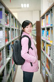 Young woman reading in library Royalty Free Stock Image