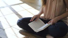 Young woman is reading a literature or learning stock video