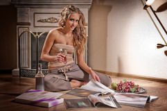 Young woman and reading magazine Stock Photography